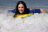 Teen girl body-boarding — Stock Photo