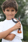 Little boy holding catapult — Stock Photo