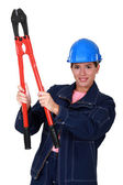 Woman builder holding nippers — Stock Photo