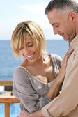 Couple by the sea — Stock Photo