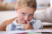Little girl pondering — Stock Photo