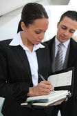 Woman planning meeting on organizer — Stock Photo