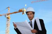 Jonge manager in bouwplaats — Stockfoto