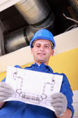 Engineer with a heating plan — Stock Photo