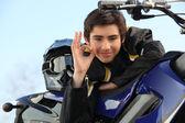 Boy with a motorbike — Stock Photo