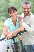 Couple with bike — Stock Photo