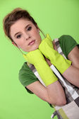 Homemaker wearing rubber gloves — Stock Photo
