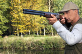 Hunter with a gun — Stock Photo