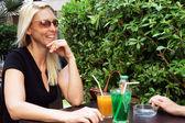 Couple sat drinking on terrace — Stock Photo