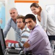Group of casually dressed working round computer — Stock Photo #9162321