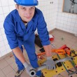 Stock Photo: Plumber measuring plastic piping