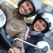 Couple riding a motor bike - Stock Photo