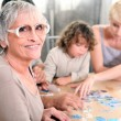 Family playing a game together — Stock Photo #9162452
