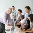 Active business team working round computers — Stock Photo