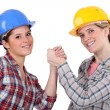 Two craftswomen arm wrestling — Stock Photo #9162815