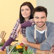 Stock Photo: Couple preparing meal together