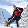 Cheerful man skiing - Stock Photo