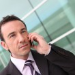 Businessman having phone conversation outdoors — Stock Photo #9163324