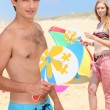 Teenager couple relaxing at the beach — Stock Photo