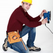 Carpenter saving time by using electric sander — 图库照片