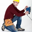 Carpenter saving time by using electric sander — Stockfoto