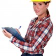 Stock Photo: Female supervisor holding clipboard