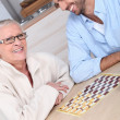 Mother and son playing draughts — Stock Photo