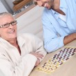 Mother and son playing draughts — Stock Photo #9164364
