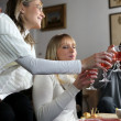 Friends drinking wine at party — Stock Photo