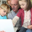 Grandparents spending time with their grandchildren — Stock Photo