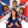Four avid French sport fans — Stock Photo