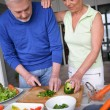 Older couple preparing a meal — Stock Photo