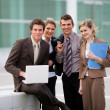 Stock Photo: Business team stood outside office block