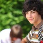 Teenage boy in the schoolyard — Stock Photo