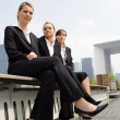 Three young businesswomen sitting on a bench — Stock Photo #9166620