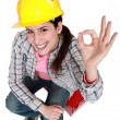 Tradeswomgiving a-ok sign — Stock Photo #9166905