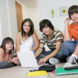 Teenagers hanging out with a laptop and listening to music — Stock Photo