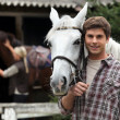 A young man with a horse. — Stock Photo #9167112