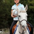 Portrait of a horseback rider - Stock Photo