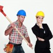 Stock Photo: Construction worker preparing to hit engineer over head