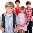Four schoolchildren with backpacks — Stockfoto #9167806