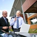 Two senior sales men on hous call — Stock Photo #9167913