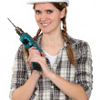Foto Stock: Tradeswomholding power tool