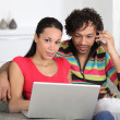 Couple enjoying modern technology — Stock Photo