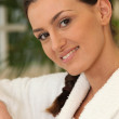 Brunette wearing bathrobe — Stock Photo