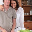 Stock Photo: Couple preparing dinner in kitchen