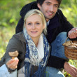 Stock Photo: Portrait of a couple collecting mushrooms