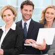 Stock Photo: Trio of dynamic businesspeople