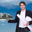 Stock Photo: Engineer holding a model of a city