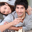 Young couple playing chess — Stock Photo #9169429